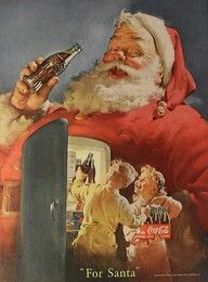 Santa enjoying a cold Coca Cola.