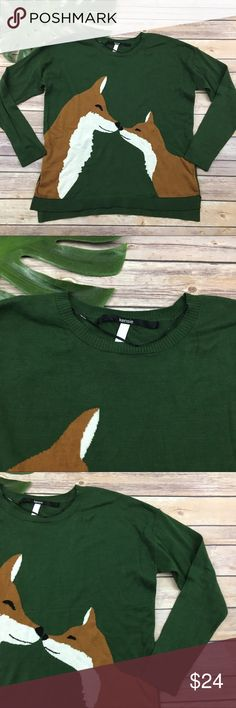 Kensie kissing foxes green sweater Kensie green foxes sweater, size M. It is free from any rips or stains. It measures about 44 inches around the bust and is about 24 inches long. Kensie Sweaters Crew & Scoop Necks