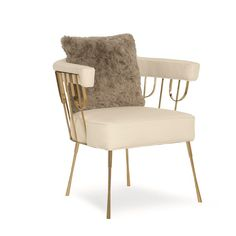 Gate Keeper : Enhance the mix in your favorite room by adding a statement chair. This chair's interesting Gold Bullion metalwork was inspired by a gate we discovered during our travels in Brussels. Its pleasing placement of brass dowels reveals just the right mix of metal against the creamy white upholstery. Minimalist in style yet supremely comfortable, it's the perfect chair to pull up to a desk or to add a little excitement to a staid mix of upholstery. Contrasting pillow in a fun faux…