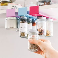 DIY spice storage! Paint the holders to match your kitchen theme but out magnets in the bottle lids so they stick!