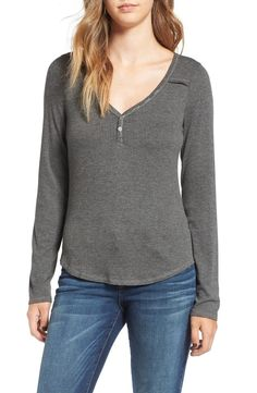 A classic henley is updated with a playful V-neck for a more feminine take on the utilitarian silhouette.