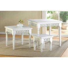 White Scrollwork Nesting Tables - There's no limit to what these enchanting White Scrollwork Nesting Tables can do for your room! Tuck the smaller two underneath to create visual interest, stagger them to make a stepped display for plants and flowers, or place them near seating areas to use as side tables.