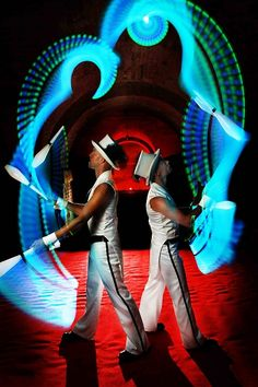 Breathtaking modern circus meets state-of-the-art light-emitting technology.    Halo is a visual feast of choreographed colour using glowing LED props to illuminate the complex patterns and textures drawn in the air by two jugglers.