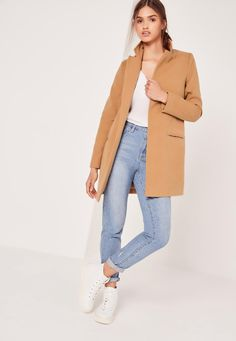 Cover up in style and work the tailored trend to the max in this beaut camel coat. In a tailored style with front pocket detail and all over camel colour, this piece will be one to covet this season. Style with a basic jersey, denim and bar...