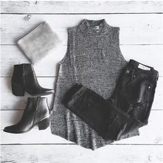 Charcoal Gray Sleeveless High Low Sweater Tank Sleeveless turtleneck sweater. High/low hem. Material: Acrylic Color: Charcoal Model is wearing a small/medium Sweaters Cowl & Turtlenecks