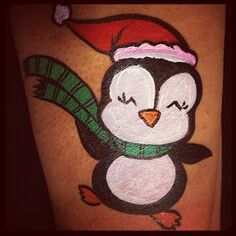 Christmas penguin face painting.