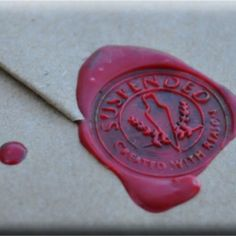 Love the simplicity - butcher paper + wax seal