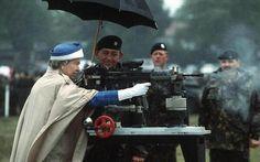 Queen Elizabeth II firing a British L85 battle rifle in Surrey, England. 1993.