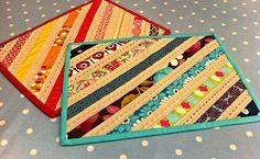 Sophie Belle Designs: Beautiful placemats. Diagnonal strips, alternate solids and prints. Quilt.