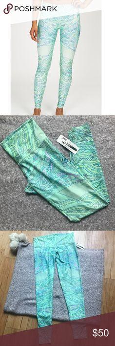 "Teeki Envisions hot pant legging green patterned L Super cool ""Envisions"" legging by Teeki. Size L. Elastic waistband. Geometric pattern. New with tags and no flaws! Original retail $72. Measurements (approximate, laid flat): Waist: 15.5"" Hip: 18"" Inseam: 28"" Leg opening: 4"" teeki Pants Leggings"