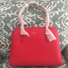 """OFFER $200 Kate spade cedar street NWT Offer $200 OR Bundle for 20% off. Retail tag price is $368. Brand new, never used Kate spade New York cedar street Maise shoulder bag in the """"cherry liqueur"""" color. A classic color and silhouette that's always in style. These pics have NO filter so you get an accurate feel for the vibrant red. I haven't taken the wrap off handles. Cross-hatched leather. 14k gold plated hardware. Zip top closure. Interior zip and center pocket. 4 feet on bottom. 13"""" w x…"""