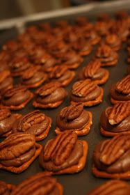 """""""Rolo Turtles"""" with a square pretzel, rolo, and pecan on top. I can't wait to put this recipe to good use!"""