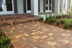 Paver driveway installed in Delray Beach, Florida using AquaPaver Autumn Blend pavers. Autumn Blend used for walkway and porch. Project by Symmetry Development. Paver Walkway, Brick Pavers, Walkways, Hardscape Design, Delray Beach, Tampa Florida, Entrance, Outdoor Living, Porch