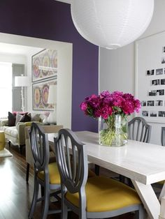 bold plum accent wall, high gloss white dining table, photo wall, grey dining chairs