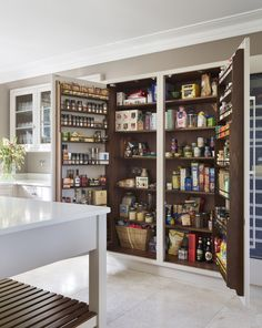 This Arts & Crafts style Surrey house has undergone a radical transformation with dated, fussy decor being replaced with a new linear design with minimal, but well-considered decorative detailing. Larder Cupboard, Kitchen Cupboards, Bespoke Kitchens, Luxury Kitchens, Martin Moore Kitchens, Kitchen Maker, Walnut Shelves, English Kitchens, Luxury Kitchen Design