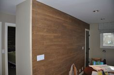 laminate flooring wall, wall decor, woodworking projects, Just need to paint the trim stick on the left side
