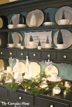Filled with bottle-brush trees and white dishes and snow-filled ornaments.