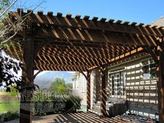Free standing pergola with Early American stain and Roosevelt Step profile. Upgraded radius roof on front side and extended rafters on back side.