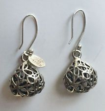 Vintage sterling silver floral design puffy dangling earrings with fis... Lot 58