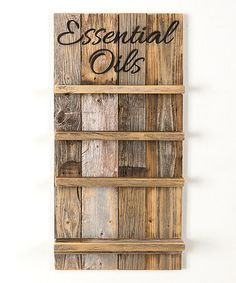 Look at this #zulilyfind! Natural 'Essential Oils' Rack #zulilyfinds This would also work if I trimed shelves with wood trim