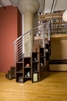 Spiral staircase around existing column incorporating storage under the treads. Via Because We Can