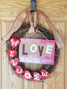 Valentine's Day Wreath, 18 in. grapevine, burlap ribbon, Welcome sign, Love is all you need sign.