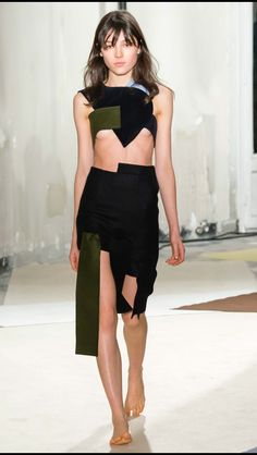 JACQUEMUS FALL RTW 2015 Using the cut and paste method. Jacquemus explores silhouette through collage relating to cut and pattern making techniques. Sticking to a simple colour palette, the real focus is on the shapes in the garment.