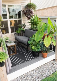 My tiny backyard updates this summer, including tons of small townhouse patio ideas, ideas for tropical plants to create privacy, and ideas for gardening in a small backyard. #outdoorspaces #smallspaces #smallpatio