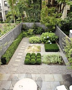 Carroll Gardens by Foras Studio The plants in the square beds are Boxwood clipped into balls, Solomon's seal, Russian sage, Mexican feather grass, and hydrangeas.