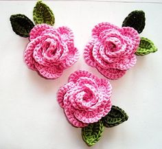 3 tiny pink flowers with green leaves, crochet appliqué