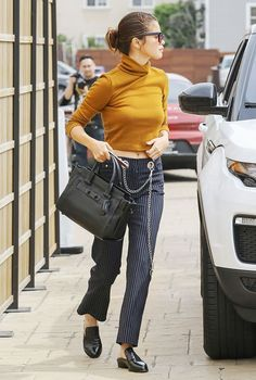 On Selena Gomez: Miaou Tommy Jean Pinstripe ($325); Robert Clergerie Alice Mules ($370); Coach bag. The pieces: Tinted sunglasses, casual cropped top, structured tote, slides.