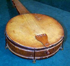 """Handmade banjo used during the Civil War by Capt. James Pinckney Thomas. The drum is made of bobcat skin. Capt. Thomas served in Company """"E"""", 18 th Texas Cavalry led by John D. Coit under Gen. Granberry, Clebourne Division. It is said of him, """"He did more good with that banjo than many a preacher, when he kept the boys in camp nights, with his playing and singing.""""  Dallas Historical Society."""