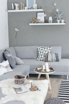 And here cold gray looks warm because of to natural materials in the room – wood and fur. Candels on the table should become inevitable detail in every home.