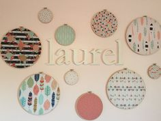 This set of 10 coordinating embroidery hoop fabric hangings will be the focal point of your babys nursery!