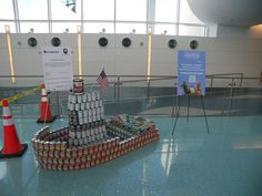 """2012 Canstruction at Jacksonville International Airport (Transportation Theme) - """"All CANS on Deck!"""" by Hubbard"""