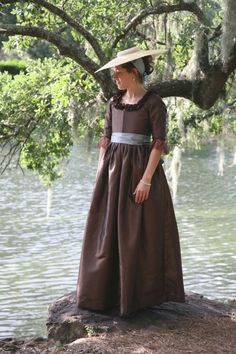 Made from my Ladies' 1780s Portrait Dress pattern, this is a chocolate brown silk taffeta with blue silk sash. The amazing photograph was taken by a dear friend of mine, who runs A Thousand Words Photography in Alabama. Sigh!