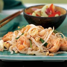 We have Pad Thai at least once a month - it's one of our kids favorites. I start with this Cooking Light recipe and modify by substituting brown sugar for the sugar, adding a tablespoon or so of peanut butter to the sauce and garnishing with cilantro a well. Usually I make it without shrimp or I'll use chicken if I have it on hand. Mouth is watering just looking at the picture :)