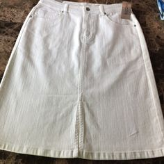 Chico's white denim skirt size 0.5 these are brand new with tags. waist to bottom 22.5 in.   Please know your size in this brand. 0.5 according to store is size 6 Chico's Skirts Midi