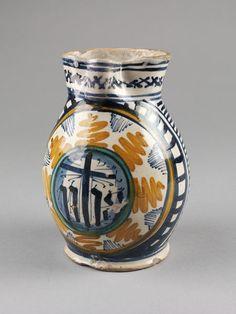 Jug with strap-like handle, Faenza, Italy, 1475-1500 Tin-glazed earthenware, H. 20 cm,  V&A, 1221-1901