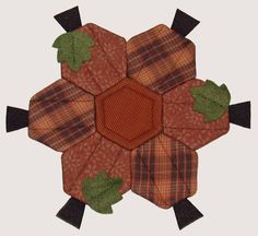 Elizabeth Coughlin Designs: I'm a Hexi Queen!----there are a few hexagon items on this page. i liked this one, thinking it is a cute one for Halloween. small ones make a coaster, medium a table mat/runner or hotpad, large ones for a wall hanging maybe. Paper Piecing, Table Runners, Fall Sewing, Halloween Quilts, Fall Quilts, Hexagon Quilt, Mug Rugs, Mini Quilts, Quilting Projects