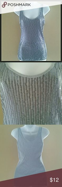 Shimmery Sequin Tank Glam gray sequin tank. Perfect with a skirt or your favorite jeans. Comfy cotton tank with sequins covering the front. Approximately 24.5 inches from shoulder to bottom of hem. 100% cotton exclusive of decoration. The Limited Tops Tank Tops