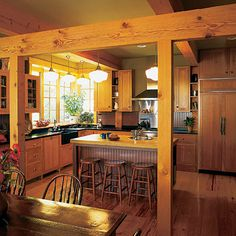 timber framing between the kitchen and dining room