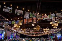 Overhead hung strings of café lights and bunting crafted from photographs of the park attached to clothespins. Eclectic-looking chandeliers also dotted the ceiling, including two different types of globular fixtures.