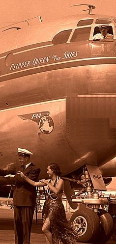 1951 Pan Am pilot & hula girl pose next to Boeing Stratocruiser Queen of the Skies tail number N90946 at Los Angeles Airport