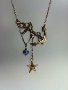 Thinking about putting a compass charm with an anchor charm like this.
