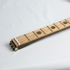 My steampunk reverse headstock cigar box guitar build.