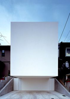 Loft House by Shinichi Ogawa & Associates Asked why his houses often lack windows that view onto the street, he explained that they come about as a result of an effort to enhance the residents' experience inside the home.