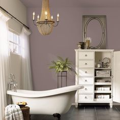 Lavender taupe -- Whites and warm lighting settle in perfectly to create a cozy corner with our 2017 Color of the Year, Poised Taupe SW 6039. #coloroftheyear #bathroomdecor #taupe