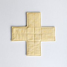Yellow, quilted, cross-shaped trivet or potholder, tableware by EdgeEffects Fabric Coasters, Cross Hatching, Swirl Pattern, Yellow Fabric, Natural Linen, Machine Quilting, Make And Sell, House Warming, Pot Holders