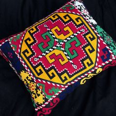 This gorgeous Suzani Pillow cases fashioned out of vintage nomads textiles from Central Asia. Great for Boho style, Bohemian and can also be mixed with contemporary, modern or ethnic decor. Ethnic Decor, Pillow Sale, Embroidered Silk, Ikat, Decorative Pillows, Hand Weaving, Pillow Covers, Textiles, Central Asia